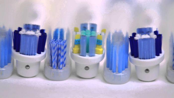 Электрическая зубная щетка орби